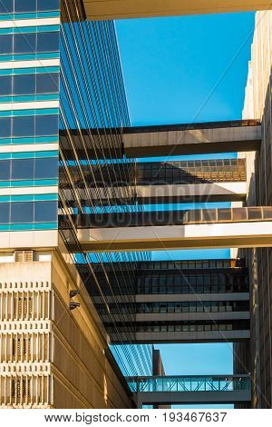 Bottom view of many passageways between office buildings on the background of clear sky Atlanta USA