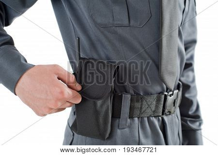 Security man pulls out the radio on his belt