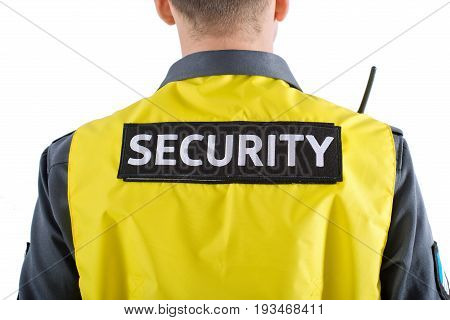 A security man with the inscription on the back of the security