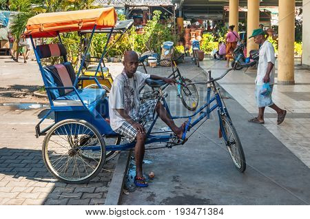Toamasina Madagascar - December 22 2017: Malagasy Man trishaw is resting while waiting for customers in Toamasina (Tamatave) Madagascar East Africa.