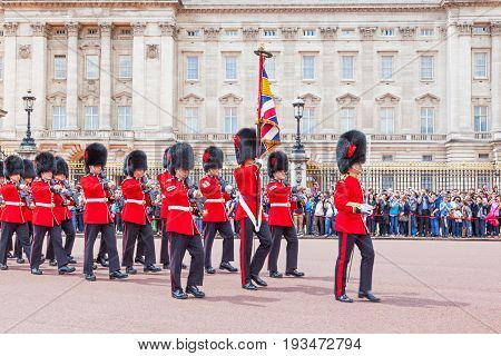 LONDON, UNITED KINGDOM - JULY 11, 2012: Officers and soldiers of the Coldstream Guards march in front of Buckingham Palace during the Changing of the Guard ceremony