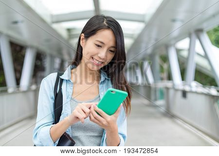 Asian woman working on mobile phone