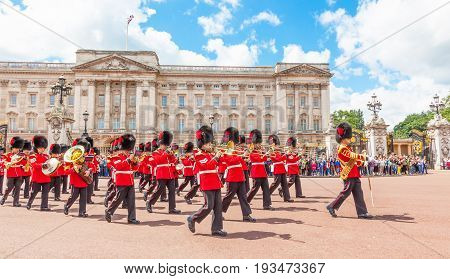 LONDON/ UNITED KINGDOM - JULY 11/ 2012: The band of the Coldstream Guards marches in front of Buckingham Palace during the Changing of the Guard ceremony.