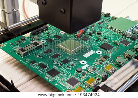 repair electronic circuit Board on infrared rework station BGA chip replacement