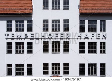 BERLIN GERMANY - JUNE 21 2017: Writing On The Wall Tempelhofer Hafen Meaning Harbor of Tempelhof In German Language In Berlin