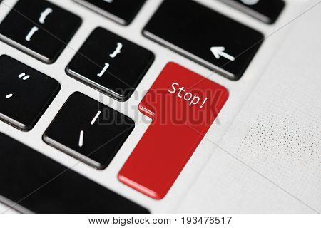 Closeup of laptop computer keyboard with red button and