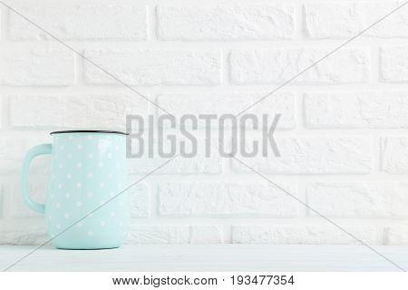 Blue Jug On A Brick Wall Background