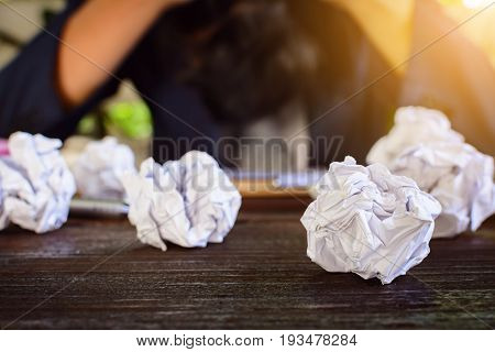 Businessmen Stress And Fear Crushed Paper On Wood Table