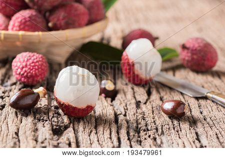 Fresh Organic Lychee Fruit On Old Wood Background