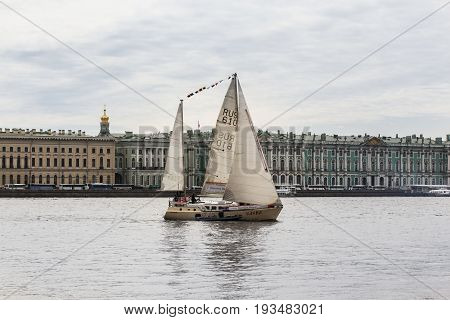 St. Petersburg Russia - 28 May, Yacht in the background of the Hermitage, 28 May, 2017. Famous sightseeing places of St. Petersburg for tourists.