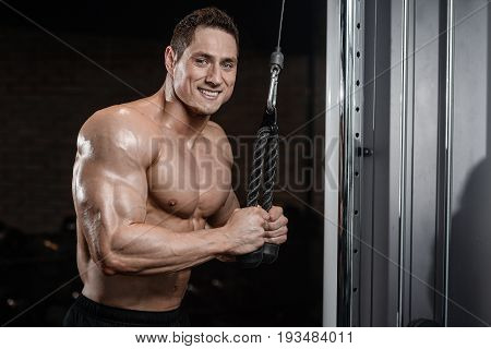 Strong Bodybuilder Man At The Gym