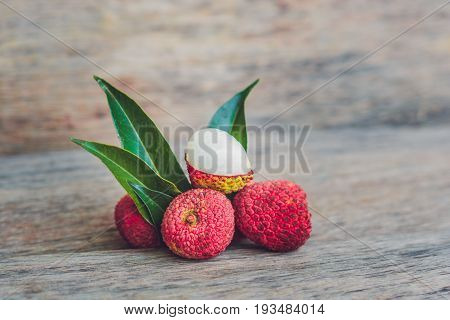 Fresh Litchi Fruit On An Old Wooden Background