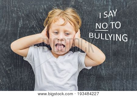 Little Boy Standing Up For Himself And Saying No To Bullying By Blowing A Raspberry At The Bully In