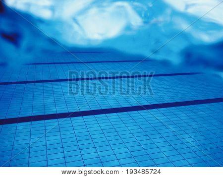 Swimming pool underwater. Underwater background. Swimming pool Underwater