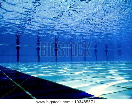 Swimming pool underwater. Underwater background. Underwater background.
