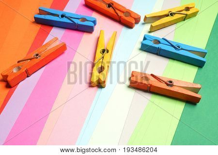 Colored clothespins on a colored background