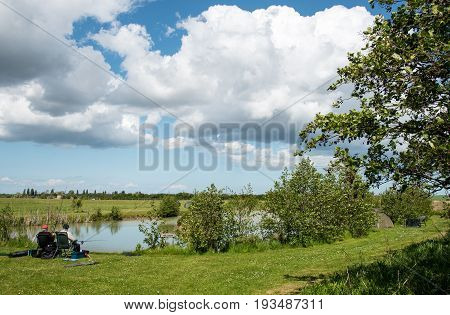 Kent United Kingdom- 14 May 2017: Mature adult men fishing at a beautiful lake near sandwich city at Kent district United Kingdom.