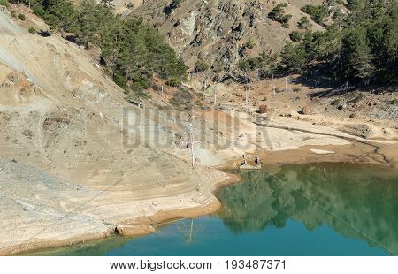 Natural small hidden lake with toxic water due to mine plant wastes at Troodos forest Cyprus