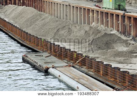 The process of construction of the embankment. Installation of metal formwork and mound.