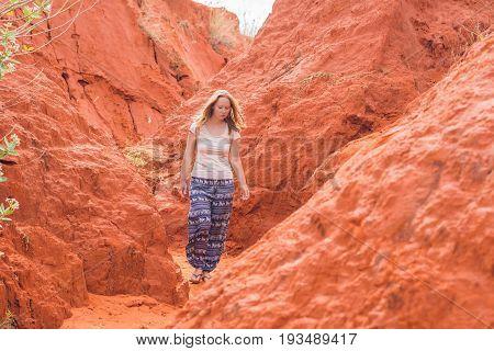 Young Woman In Red Canyon Near Mui Ne, Southern Vietnam