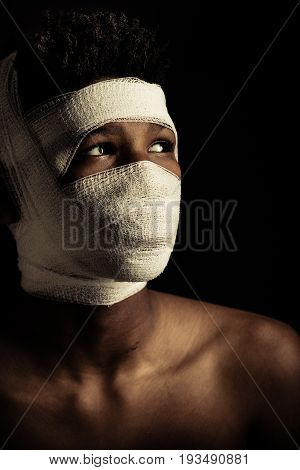 African Boy With His Head Swathed In A Bandage