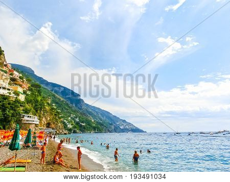 Positano, Italy - September 11, 2015: The people resting at the beach at Positano at Amalfi Coast on September 11, 2015