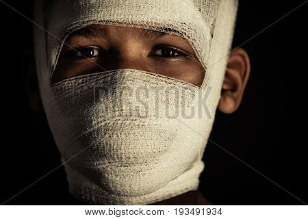 Young Black Boy With Bandages On His Face