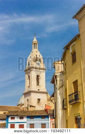 Tower Of The Santa Maria Church And Colorful Houses In Xativa