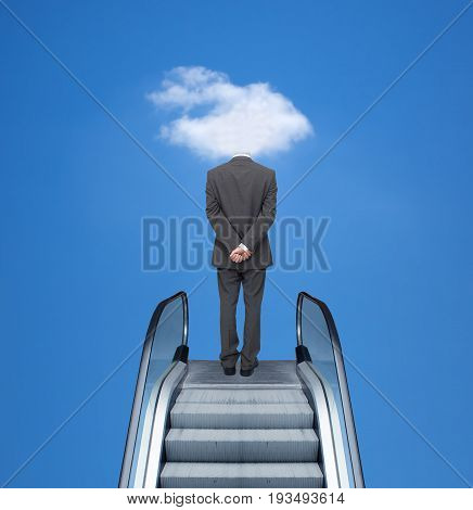 Successful businessman travels on the escalator to the cloud.