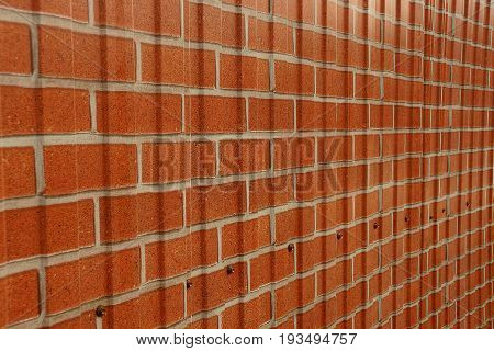 Texture of a paper wall with painted red brick