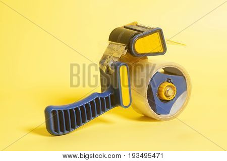 Dispenser Tape On A Yellow Background .