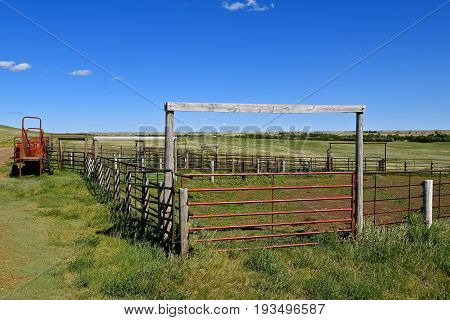 An empty corral on a westernranch for loading beef cattle also includes a portable loading chute