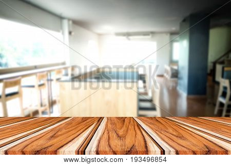 Selected focus empty brown wooden table and Coffee shop or cafe blur background with bokeh image. for your photomontage or product display.