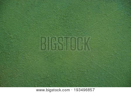 Green background from a part of the concrete foundation of a residential building