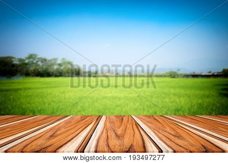 Selected focus empty brown wooden table and blue sky or mountain blur background with bokeh image. for your photomontage or product display.