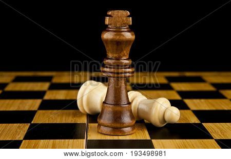 chess on a black background. Business strategy concept