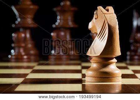 photo of white knight chess on chessboard for game