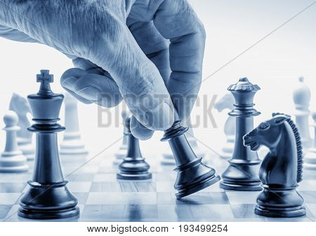 Hand moving pawn. Strategic move concept in business