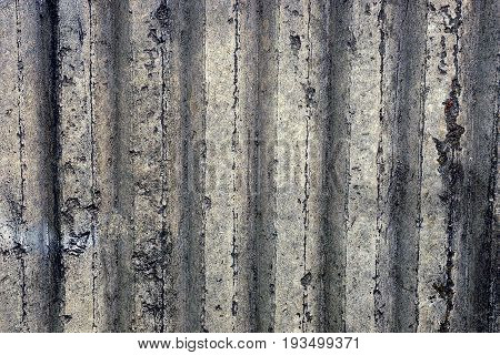 Gray ribbed background of a concrete wall part of a private building