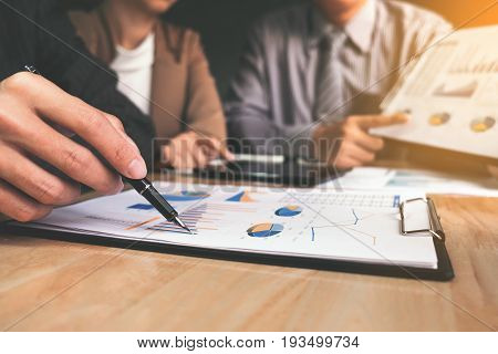 Co working conference Business team meeting present investor colleagues discussing new plan financial graph data on office table with laptop and digital tablet Finance accounting investment.