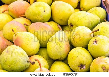 Background from yellow pears for sale at a market