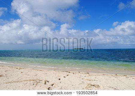 Micro Beach on a bright sunny day Micro Beach in Garapan, Saipan with