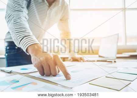 Business Financing Accounting Banking Concept businessman doing finances and calculate about cost to real estate investment and in other tax system.