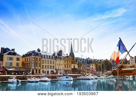 Beautiful view of the historic Honfleur harbor with sailboats at sunny day