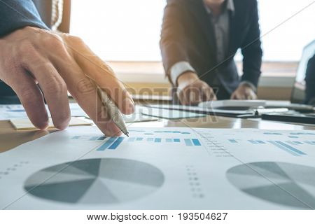 Business team meeting present. secretary presentation new idea and making report to professional investor with new finance project plan during discussion at meeting