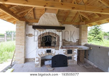 Architecture house old style porch with grill fireplace outdoors