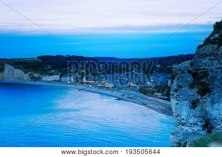 Aerial view of night Etretat city with its famous cliffs and coastline, Normandy, France