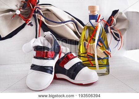 greek Orthodox christening objects - baby shoes and the baptism oil
