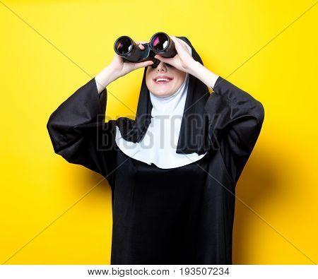 Young Happy Nun With Binoculars