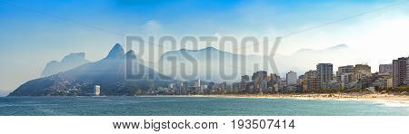 Panoramic landscape of the beaches of Arpoador Ipanema and Leblon in Rio de Janeiro with sky and the hill Two brothers Vidigal and Gávea stone in the background